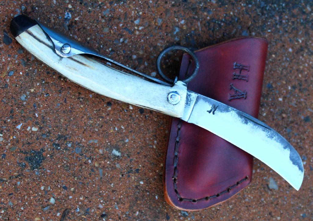 Couteau pliant à palme